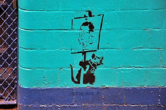 Banksy自画像与它的招牌老鼠.jpg